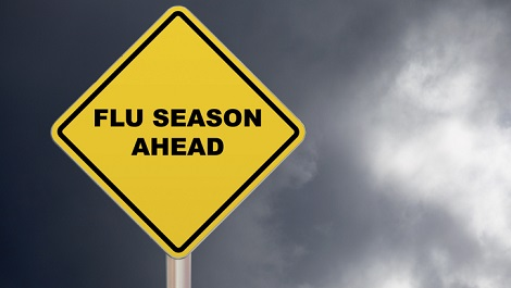 Sign saying flu season ahead.