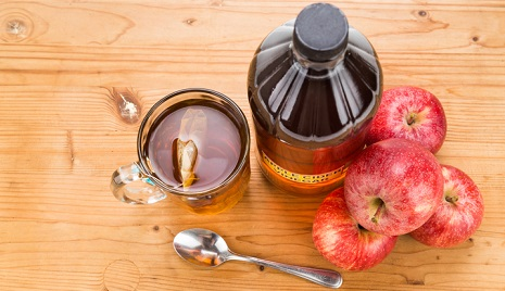 Apple cider vinegar on a table.