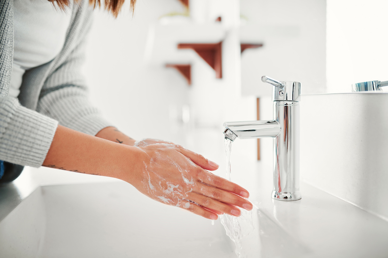 Woman washes hands