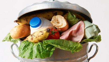 Food stuffed in a garbage can.