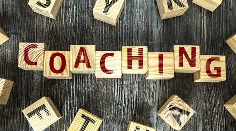 Coaching spelled out on blocks.