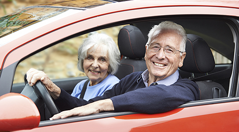 Older adults driving in a car.