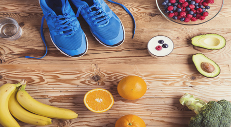 Running shoes surrounded by fruit.