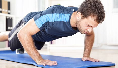 Man doing push-ups at home.