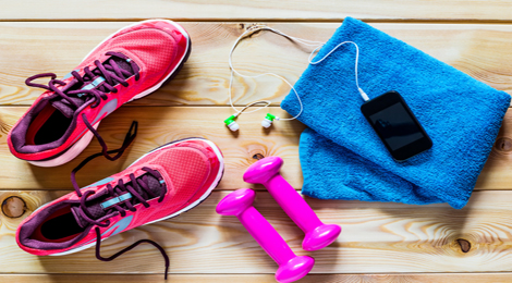 Workout shoes, iphone, weights, and towel.