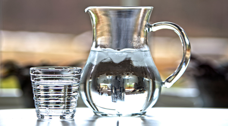 A pitcher and glass of water.