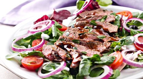 Grilled marinated lamb and red pepper salad