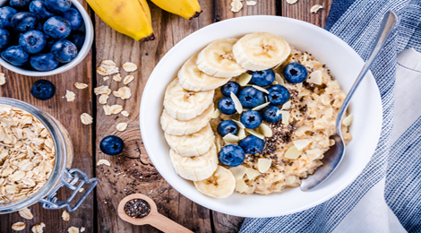 A warm bowl of oatmeal with blueberries.