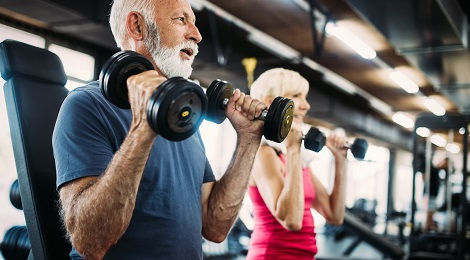 Couple with Alzheimer's disease exercising in a gym.