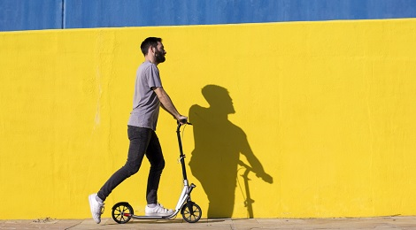 Man riding a scooter.