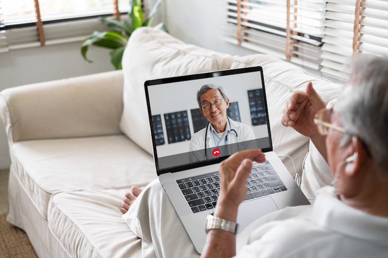 A man participates in a virtual visit with his doctor.