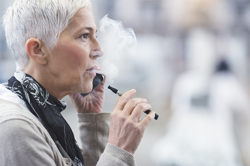 Woman vaping.