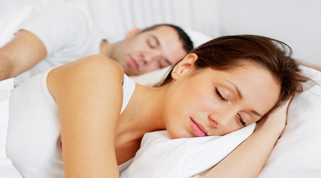Young couple sleeping in bed.