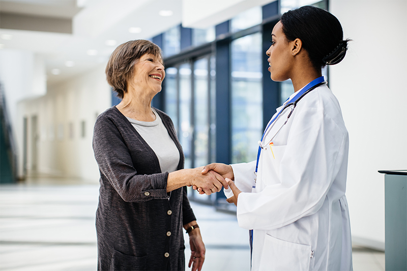 A woman speaks with her physician.