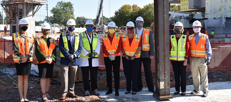 Piedmont Athens joined donors to set first steel column for new patient tower.